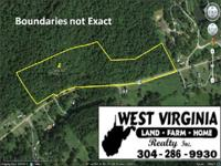 This beautiful 14.03 acre wooded tract with road