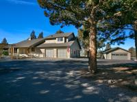 Enjoy Cascade Mountain views while entertaining in this