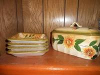 Sunflower canister and set of 4 plates. $15.00. Call .