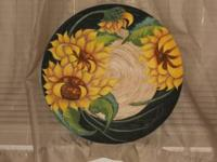 This is hand painted in acrylic with sunflowers, can be