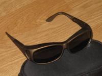 NEW with Case. These over your RX sunglasses are found