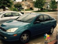2001 Ford Focus with 123,385 miles. Perfect second car