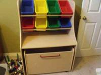 Great toy box for sale. Top has 8 brightly colored bins