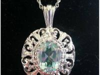 Very pretty and unique pale greenish topaz locket set