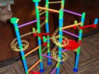 Large marble run with directions.