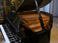 Superb Baby Grand Piano (Ebony Finish). Make: Young
