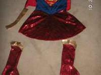 This is a super cute SUPERGIRL costume for a little