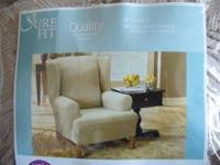 A one piece Sure Fit Wing Chair Cover fits most