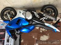 Hi, I am offering a 2009 Blue and White GSX650F. It has