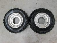 FOR SALE IS A SET OF TIRES AND WHEELS OFF OF A SUZUKI