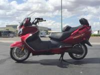 This Burgman comes with a 400cc, 4-stroke,