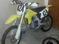 2006 RMZ450 low miles. Clean. Suspension set up for