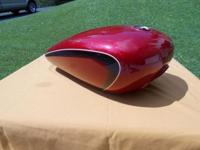 Suzuki gas tank. Nice shape. Small storage ding. Great