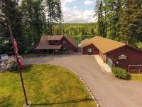 Classic 2,159 sq. ft. Log Home on 176 ft of level Swan