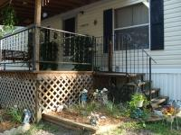 Immaculate DWMH on 1.25 acres, all wire mesh fence,