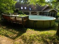 "Above ground pool 27' x 52"" pool 7 ' deep end and"
