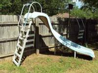 Swimming pool slide. Ladder, hose hook-up and water
