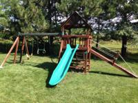 Great swing set with club house, walking ramp, and