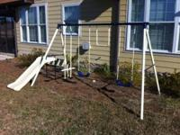 Nice swing set with two swings, a glider swing, swing
