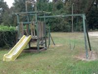 Pictured is a solid wood swing set from Child Life Inc.