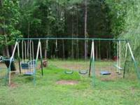 Big swing set. Has two swings, a stand up swing, arm