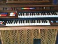 This is a Kimball Swinger 700 organ that is in mint