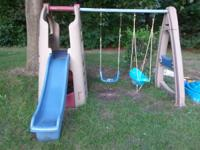 Swingset with slide and playhouse below slide.  Good