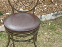 This is nice bar stool chair with a metal base and a