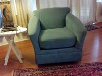 This is a Stanley Chair Swivel Rocker Chair in Aqua
