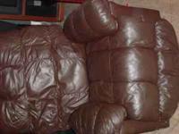 Chocolate Leather Rocker Recliner (swivel) small tear
