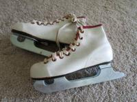 $10. Trainer, double blade ice skates. Sz 12 girls.