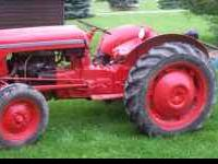 This is a great tractor! It has a 3-point hitch and