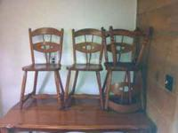 Nice wooden table and 4 chairs. Solid! Shows some