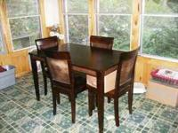 Beautiful, dark cherry Dinning room table & 4 matching