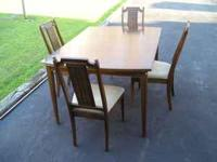 Dining room style table and four chairs. Pressed wood.