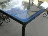 "Glass table with metal framing. 36"" wide 52"" long 22.5"""