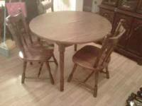 Nice wood table and 2 chairs for $45. Can be seen at
