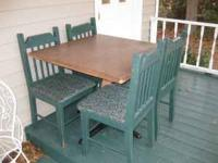 Table and 4 durable chairs in good condition. If