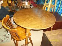 Very nice table and chair set. Comes with 5 chairs and