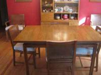 47 inch table with two 12 inch leaves; 6 padded chairs