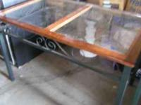 I have a green metal Table, glass top with cherry wood