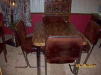 table and chairs with extention leaf,good shape,$50.00