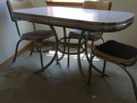 1950 chrome and formica table with four chairs. Grey