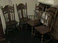 Country style table with pedestal legs and 4 chairs.