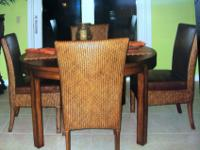 We have a Table and four Chairs to sell. The table is