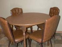 "42"" Round laminate wood dining room table and four"