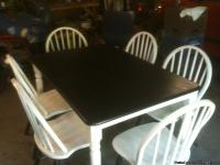 All  wood table chairs, this has been refurbished.
