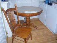 """kitchen table and four chairs table is 42"""" in dia. it"""