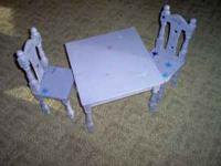 Purple table with two matching chairs $20.00 for the