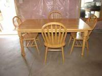 Table with 4 chairs. Asking $75. Call -